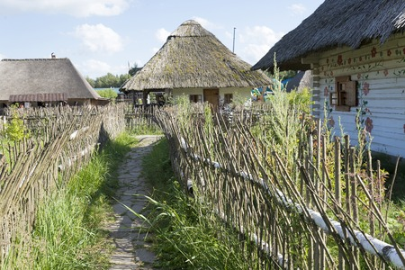 Old houses with thatched roofs in summer Sunny day.