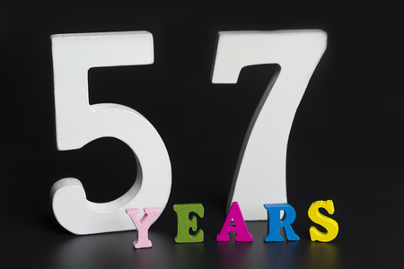 Letters and numbers-fifty-seven on black isolated background. Stock Photo