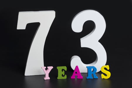 Letters and numbers-seventy-three on black isolated background. Stock Photo