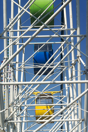 Cabins of the Ferris wheel at the amusement Park closeup.