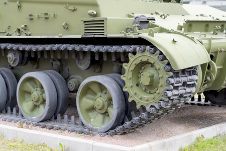 Tank caterpillar tread with wheels. Modern military equipment.