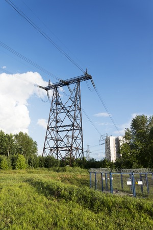 Power line in a wooded area. Forest landscape on a Sunny summer day.