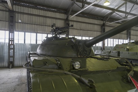 The average Soviet t-55 tank close-up in the Museum. Soviet military equipment. Stok Fotoğraf - 117681884