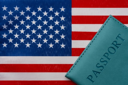 Against the background of the flag of the Small Pacific remote Islands of the United States is a passport. The concept of travel and tourism.