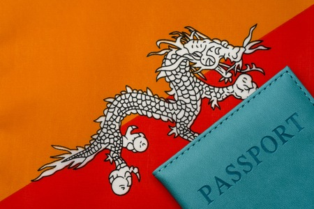 Against the flag of Bhutan is a passport. The concept of travel and tourism.