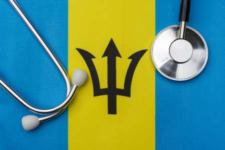 Flag of Barbados and stethoscope. The concept of medicine. Stethoscope on the flag in the background.