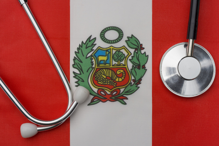 Peru flag and stethoscope. The concept of medicine. Stethoscope on the flag in the background.