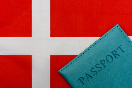 On the flag of Denmark is a passport. The concept of travel and tourism to foreign countries.