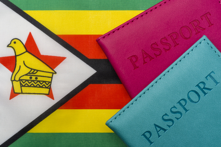 On the flag of Zimbabwe is a passport. The concept of travel and tourism to foreign countries. 写真素材