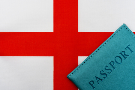 On the flag of the English Kingdom is a passport. The concept of travel and tourism to foreign countries.