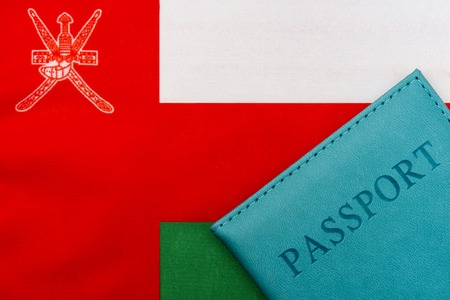 On the flag of Oman is a passport. The concept of travel and tourism to foreign countries. 写真素材