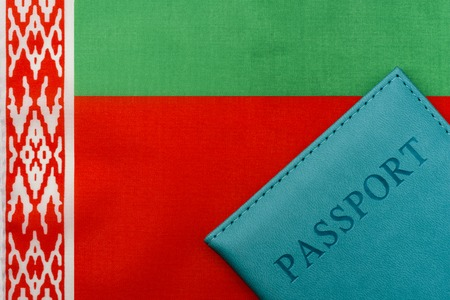 On the flag of Belarus is a passport. The concept of travel and tourism to foreign countries. 写真素材