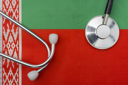 Flag of Belarus and stethoscope. The concept of medicine. Stethoscope on the flag in the background.