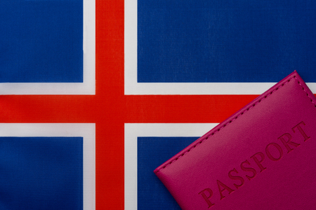 On the flag of Iceland is a passport. The concept of travel and tourism.