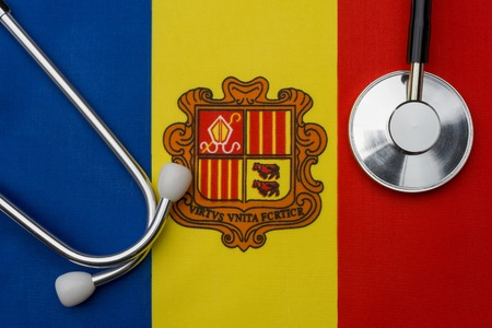 Andorra flag and stethoscope. The concept of medicine. Stethoscope on the flag in the background.