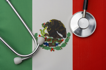Mexico flag and stethoscope. The concept of medicine. Stethoscope on the flag in the background.