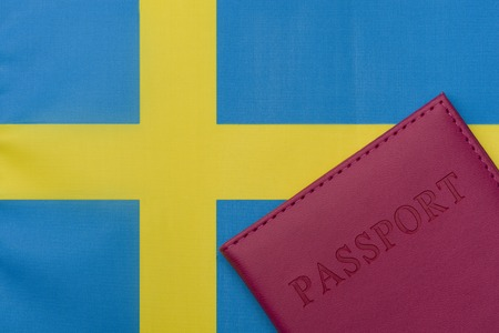 On the flag of Sweden is a passport. The concept of travel and tourism.