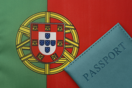 On the flag of Portugal is a passport. The concept of travel and tourism.