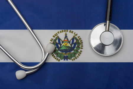 El Salvador flag and stethoscope. The concept of medicine. Stethoscope on the flag in the background.