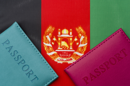 On the flag of Afghanistan is a passport. The concept of travel and tourism to foreign countries.