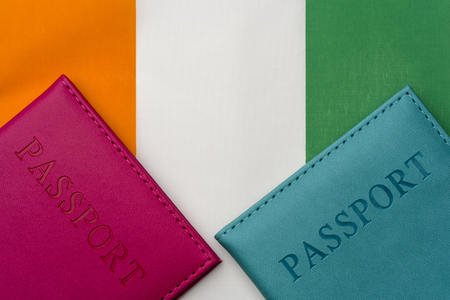 On the flag of cote d'ivoire is a passport. The concept of travel and tourism to foreign countries.
