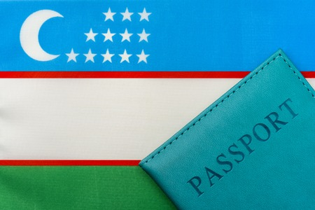 On the flag of Uzbekistan is a passport. The concept of travel and tourism.