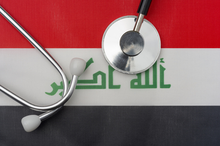 Iraq flag and stethoscope. The concept of medicine. Stethoscope on the flag in the background. Stock Photo