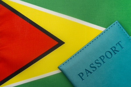 On the flag of Guyana is a passport. The concept of travel and tourism. Reklamní fotografie