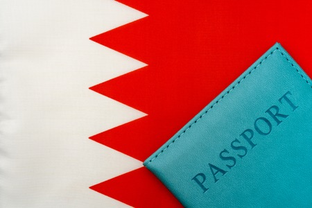 On the flag of Bahrain is a passport. The concept of travel and tourism.