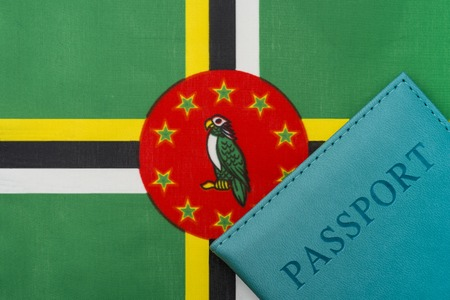 Theres a passport on Dominics flag. The concept of travel and tourism. Reklamní fotografie