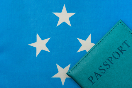 On the flag of Micronesia is a passport. The concept of travel and tourism. 写真素材