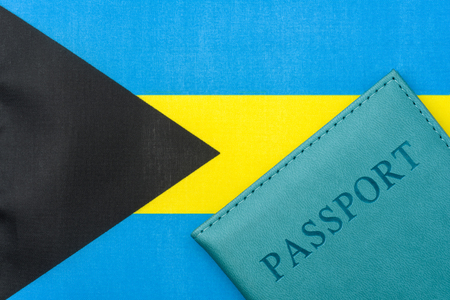 On the flag of the Bahamas is a passport. The concept of travel and tourism.