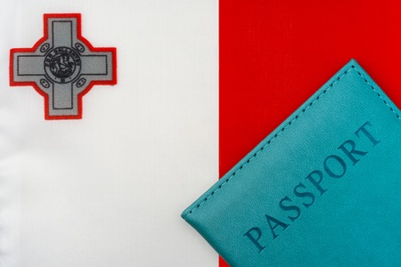 On the flag of Malta is a passport. The concept of travel and tourism.