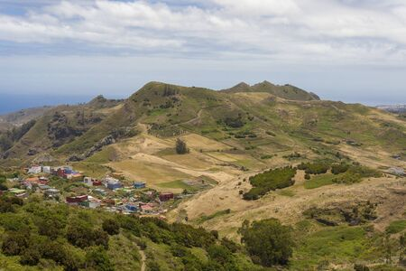 View of the mountains and the city on the island of Tenerife. The concept of travel and tourism in the Canary Islands on a summer day.