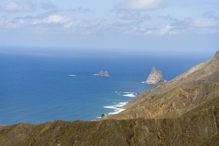Mountains and sea on the island of Tenerife. The concept of tourism and recreation on a summer day. 스톡 콘텐츠