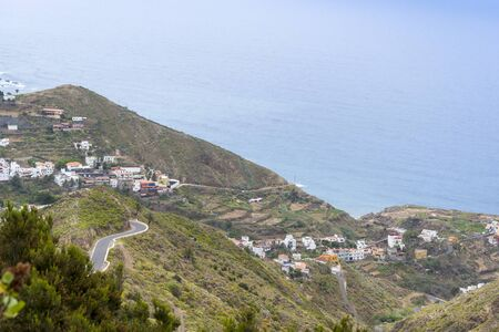Houses on the mountains of Tenerife near the sea. The concept of recreation and tourism in the Canary Islands on a summer day.