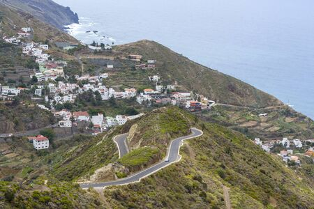 Mountains and roads on the island of Tenerife. The concept of travel and tourism in the Canary Islands on a summer day. 스톡 콘텐츠