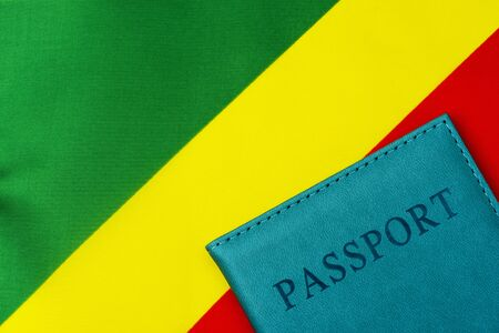 On the background of the flag of the Republic of Congo is a passport. The concept of travel and tourism.