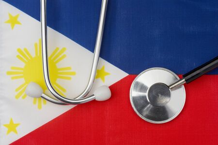 Philippine flag and stethoscope. The concept of medicine. Stethoscope on the flag in the background.