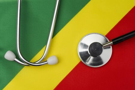 Flag of the Republic of Congo and stethoscope. The concept of medicine. Stethoscope on the flag in the background.