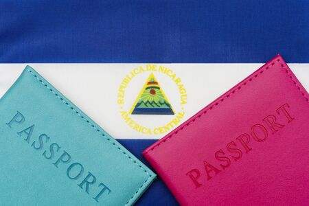 On the background of the flag of Nicaragua is a passport. The concept of travel and tourism.