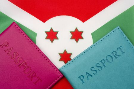 On the background of the flag of Burundi is a passport. The concept of travel and tourism. 写真素材