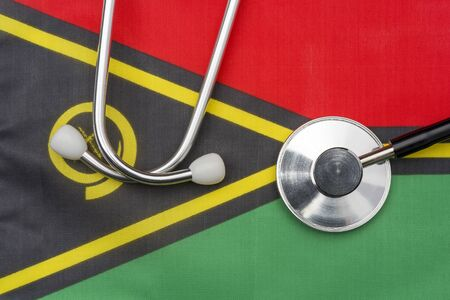 Vanuatu flag and stethoscope. The concept of medicine. Stethoscope on the flag in the background. Zdjęcie Seryjne