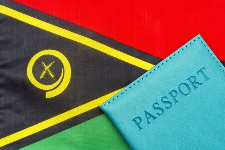 On the background of the flag of Vanuatu is a passport. The concept of travel and tourism.
