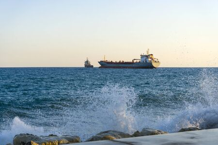 Ship in the Mediterranean sea off the coast of Cyprus. Ships near the port city of Limassol Cyprus.