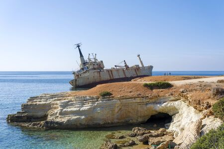 Abandoned ship that was shipwrecked off near the coast of Cyprus. An abandoned ship aground.