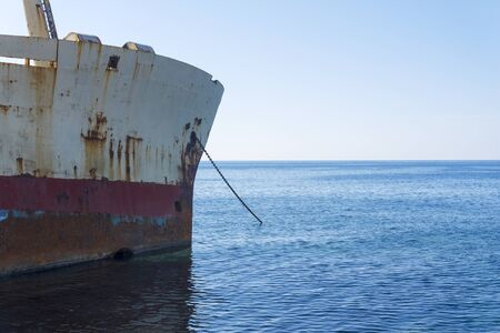 An old rusty ship on the island of Cyprus. The concept of travel and tourism.