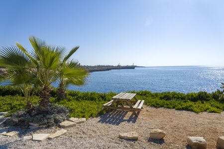 Picnic bench Overlooking the Sea on a summer day. the concept of recreation and entertainment. Фото со стока