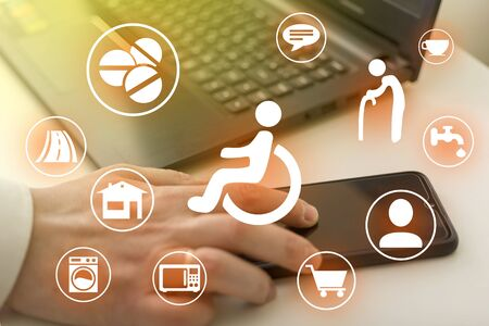 Disabled icons on the computer background. Assistance to the disabled. Concept of development of the system in helping disabled people with the help of a computer.