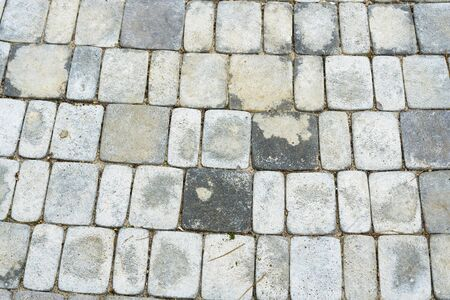 Abstract background - gray paving slabs in the form of squares. Texture of paving slabs. Фото со стока